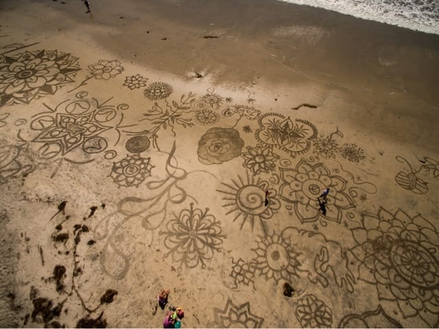 Sand Artist Tattoos The Beach To Make Incredible Artwork