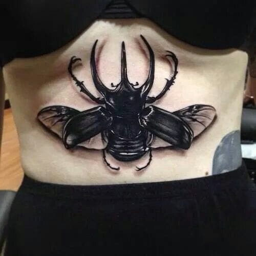 Underboob tattoos on women are sexy. Agree or disagree? Sternum tattoo by Benjamin Laukis.