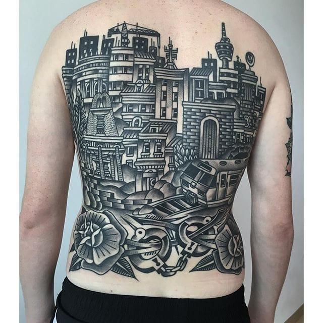 Stunning city backpiece #blackwork #traditional #backpiece #luxianostreetclassic