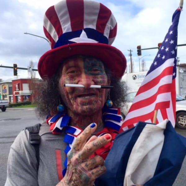 Man Has USA Flag Face Tattoo