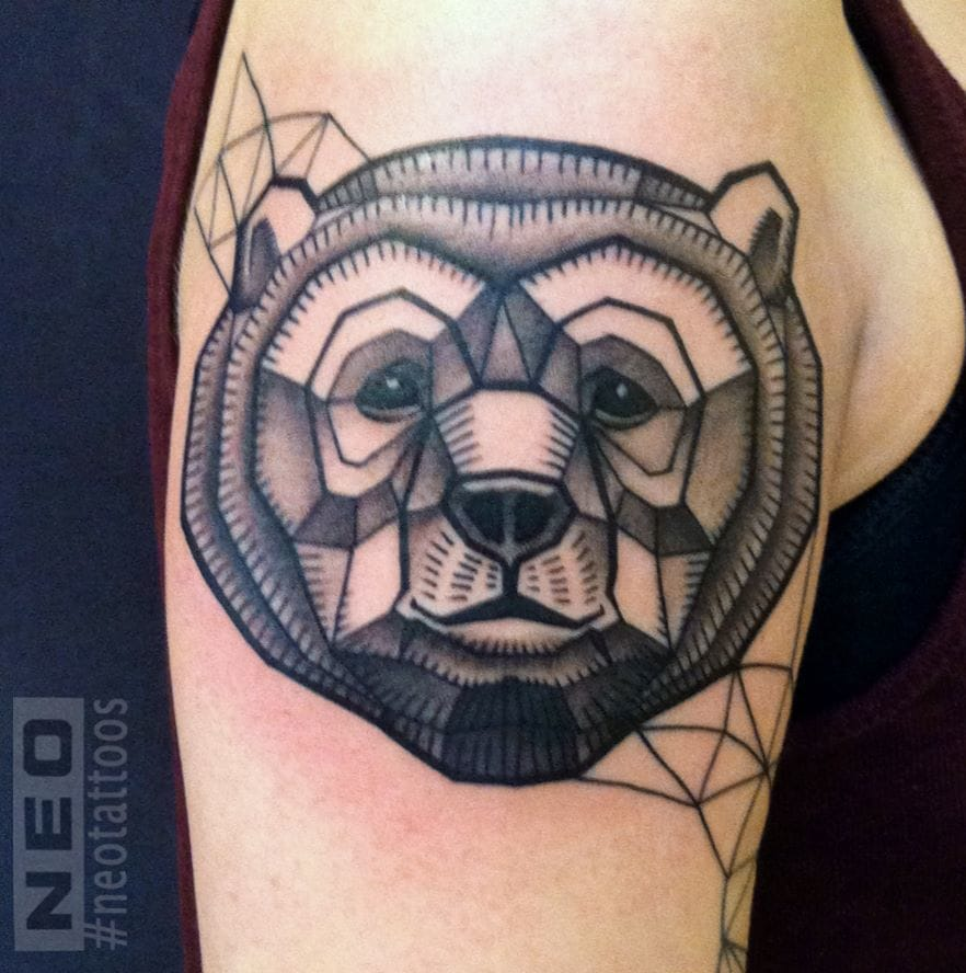 Bear with sympathetic eyes drawn using geometric shapes. Notice the subtle shading within the polygons