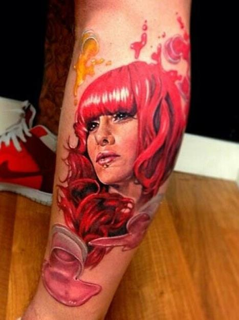 Another pretty tattoo artist is Moni Marino, here by Kris Busching.