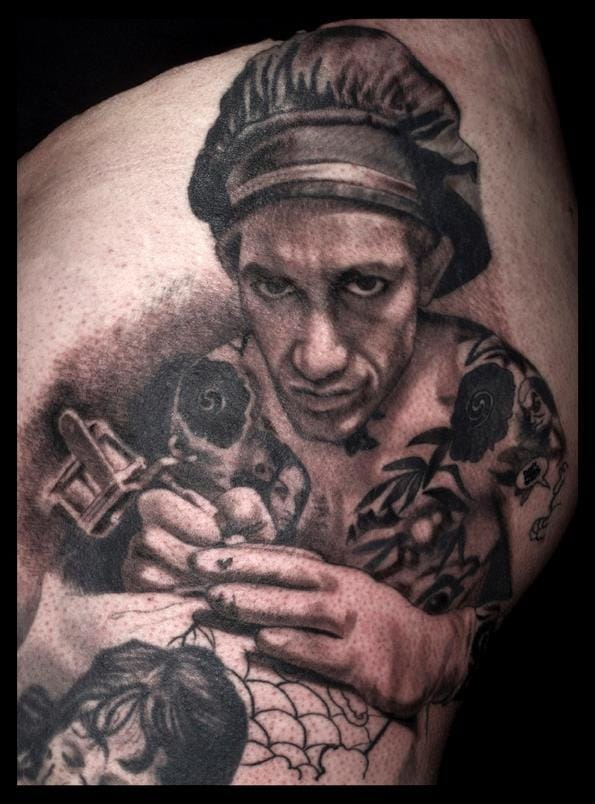 Japanese tattoo master Filip Ley inked by French legend Tin-Tin.