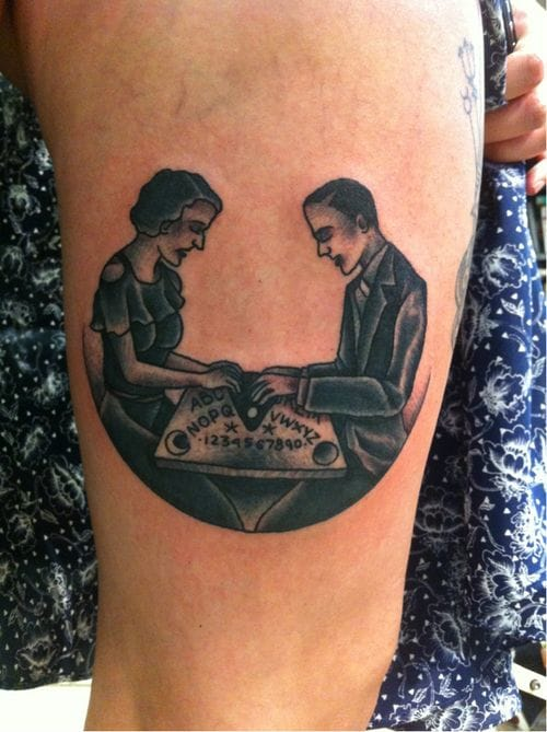 Tattoo by Simon Erl inspired by a vintage illustration of a couple playing the ouija board game.