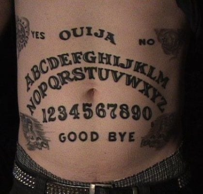 Stomach ouija board tattoo.