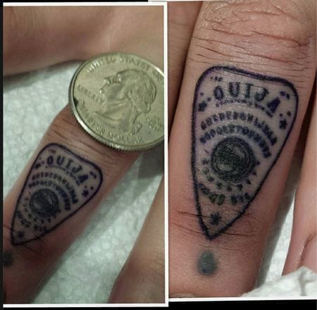 Very small planchette on the finger.