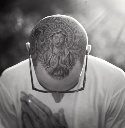 Travis Barker's head tattoo by Mr. Cartoon.