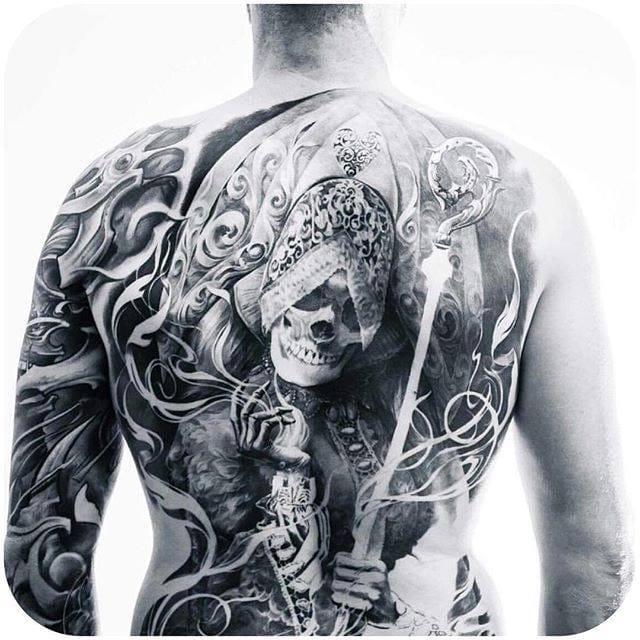 Stunning Black & Grey back piece by Carlos Torres. (Instagram:carlostorresart) #blackandgrey #skeleton #backpiece #carlostorres