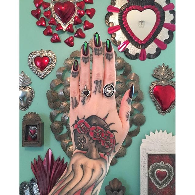 Megan Massacre shows her Sacred Heart collection, including a traditional one on her hand made by Tim Hendricks. (Instagram: @timhendricks, @megan_massacre)  #blackandgrey #traditional #sacredheart #immaculateheart