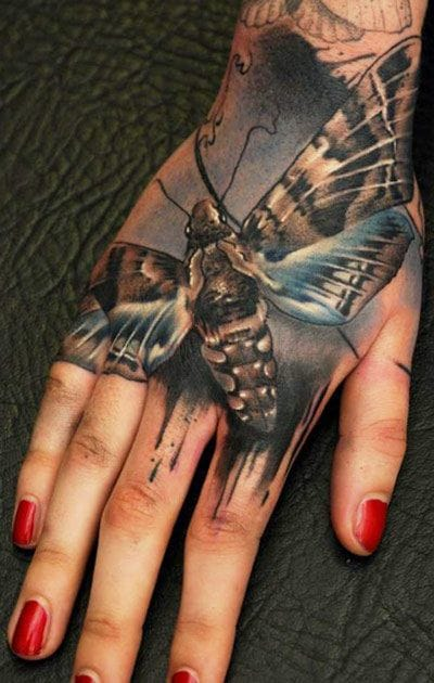 Where to place your bugs? The hand's one of the few good spots! Tattoo by Florian Karg.