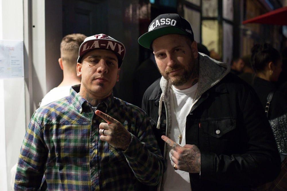 Tattoo artistsTommy Montoya and Luke Wessman chillin' outside.