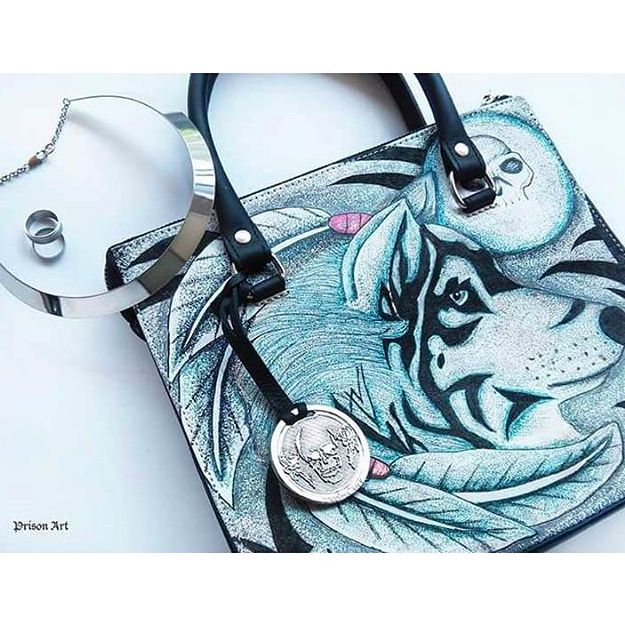 Purse by Prison Art with a beautiful wolf design via Instagram @prison.art #prisonart #fashion #tattoofashion #purse #tattoodesign #wolf