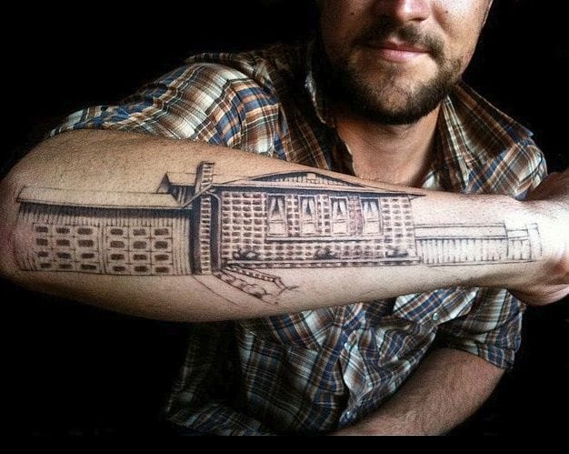 A building on your arm, tattoo by Electro LadyLux.