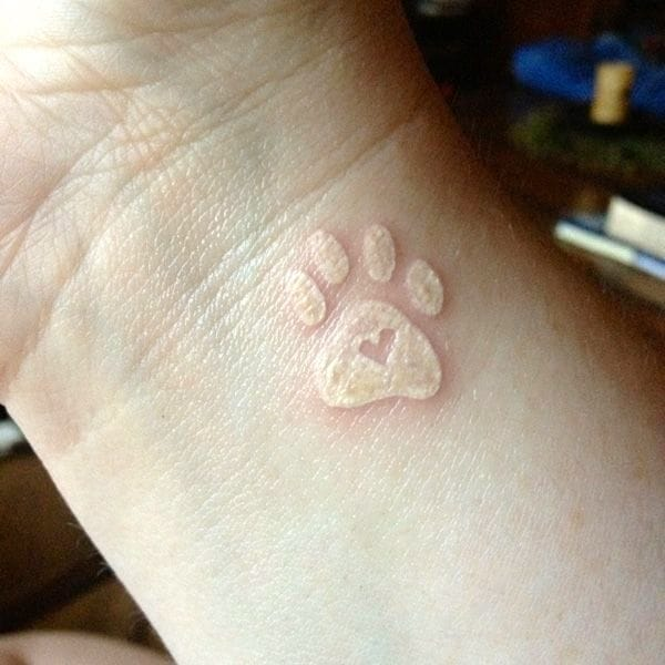 Puppy love. Interesting white ink. Great size and placement.