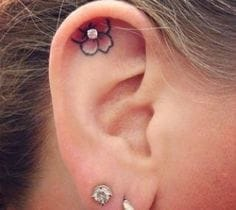 Pink flower with a piercing in the middle