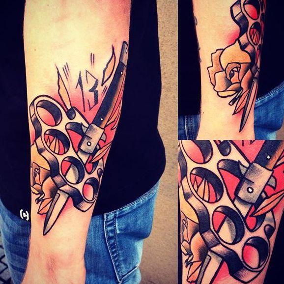 10 Tough Brass Knuckles Tattoos