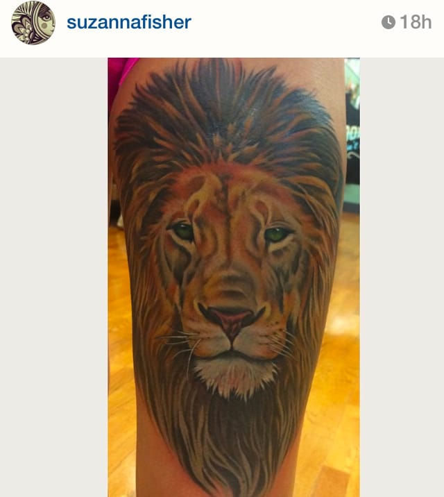 Space is a big reason for a thigh tattoo, there's plenty to work with. Color realism in a front thigh piece by artist Suzanne Fisher. #suzannefisher #thigh #realism #lion