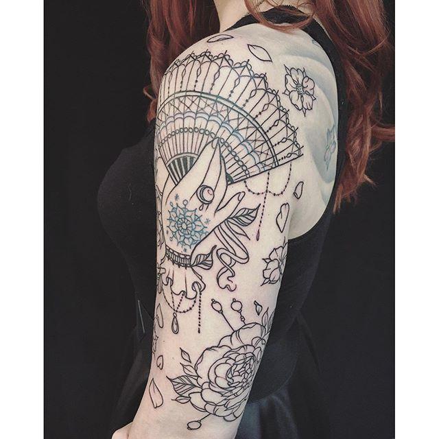 13 Delicate Hand Held Fan Tattoo Designs