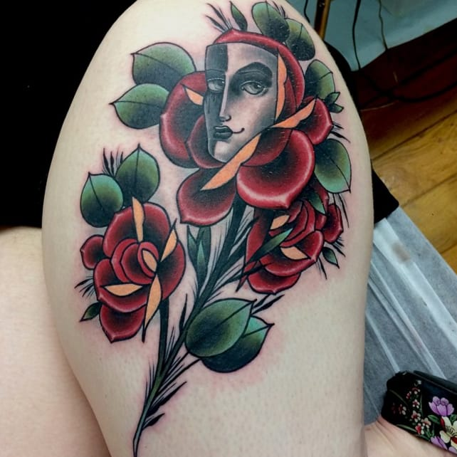 10 Dramatic Theatre Mask Tattoos