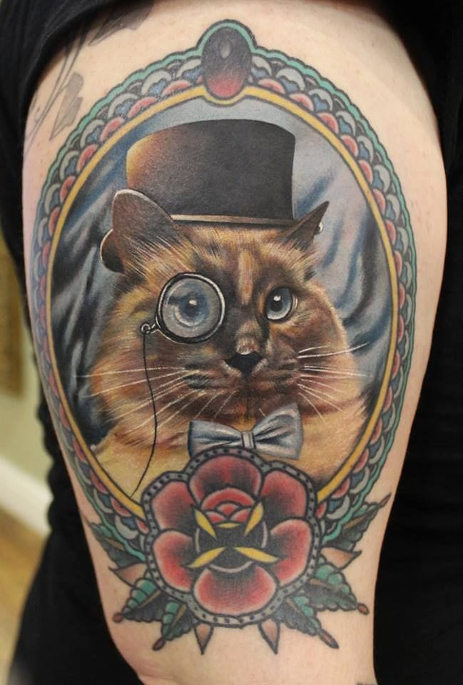 Animals dressed up as gents is a common trend nowadays. Tattoo by Phatt German, Cloak & Dagger Tattoo Parlour