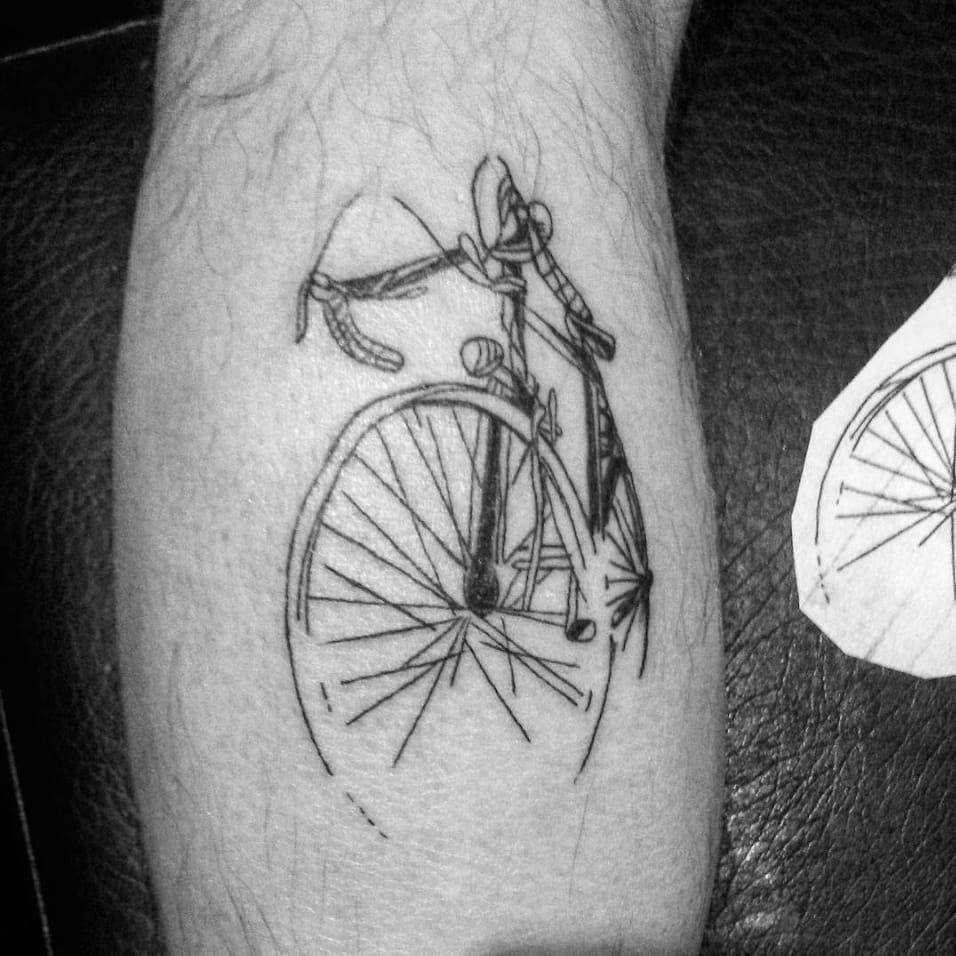 Sketch like bicycle tattoo by @serhatunvertattooart from Instagram #bicycle #bicycletattoo #sketch #drawing #simple #blackwork #delicate #blackwork