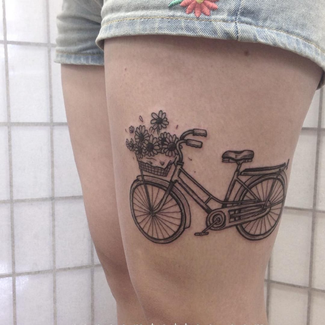 Bicycle with flowers tattoo by @davidransom from Instagram #bicycle #bicycletattoo #flowers #blackwork #simple #detailed #blackwork