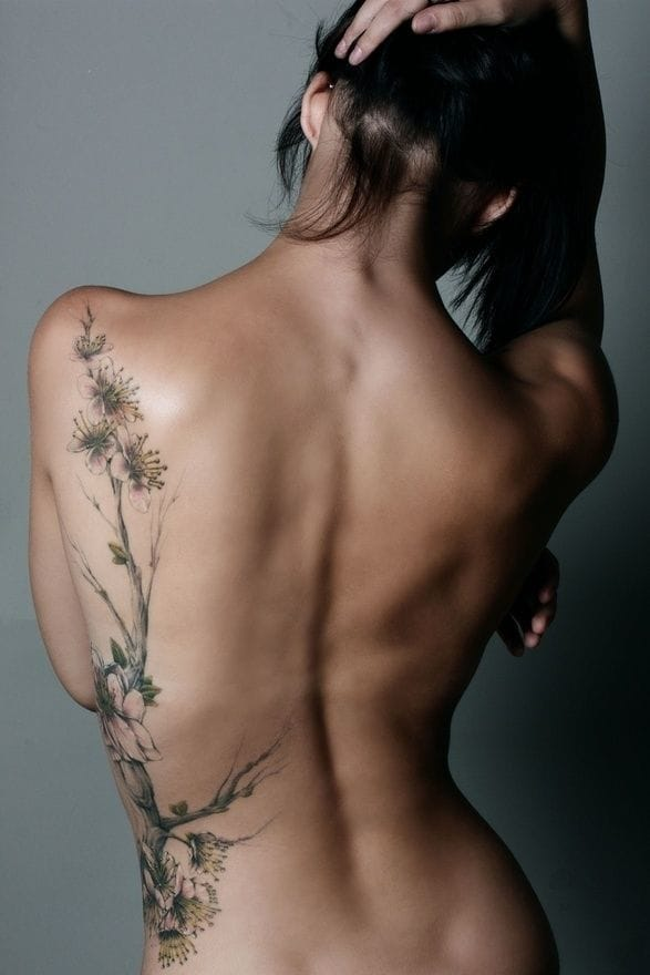 Propably not a real tattoo, but some inspiration for a sensual botanical tattoo.