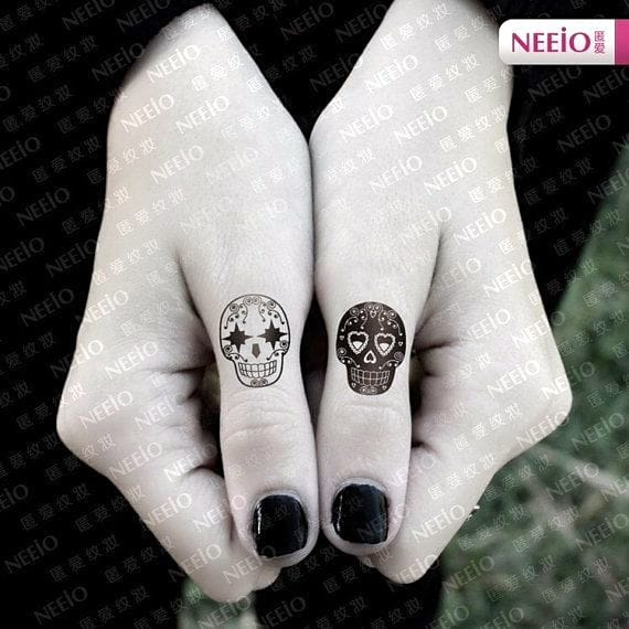 Great feminine designs. Not a real tattoo, but nice contrasting sugar skulls.