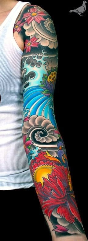 Lots of color in this Japanese sleeve found on durbmorrison.com, more Japanese tattoos.