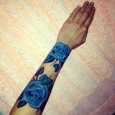 A color twist on the classic, lovely blue roses.
