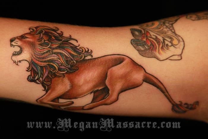 Lion tattooed on the inner arm featured on New York Ink.