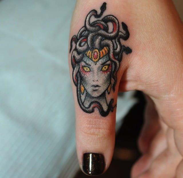 Freakishly Good Finger Tattoos (continued)