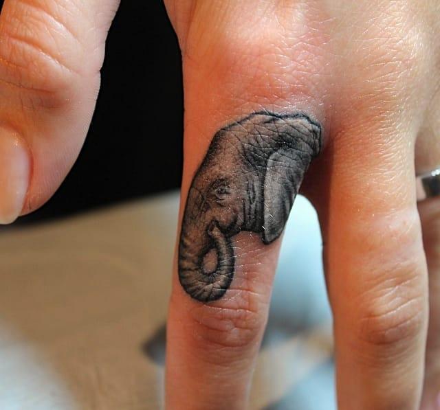 elephant tattoo,done by @lazerliz tattoos