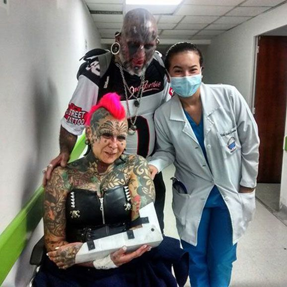 Tattoo World Record Holder Gaby Peralta Falls During Suspension Show