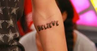 Bieber's album title that he had tattooed on his inner arm.