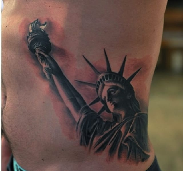 Lady Liberty on the ribs by Anatole.