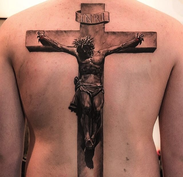 """Starting the tattoos of with a bang, or Bang Bang since that's where this crucifix was tattooed. Remarkable shading complete with INRI above Christ's head, meaning """"King of the Jews"""" in Hebrew. The detail is crazy seriously, zoom in on this thing."""