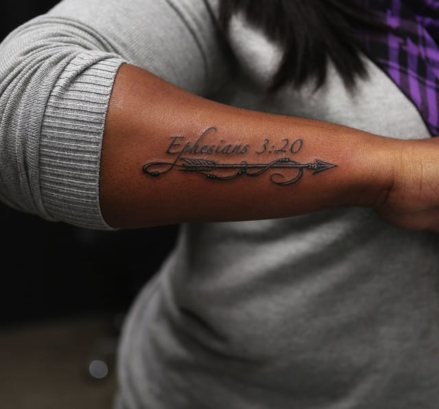 Scripture on the outer forearm, pristine work by Bang Bang.