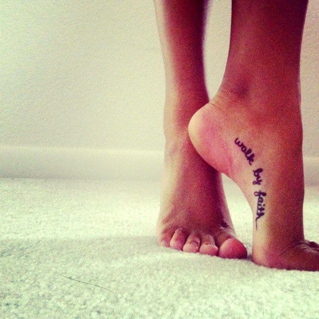 Another more discreet walk by faith script tattoo on the foot.