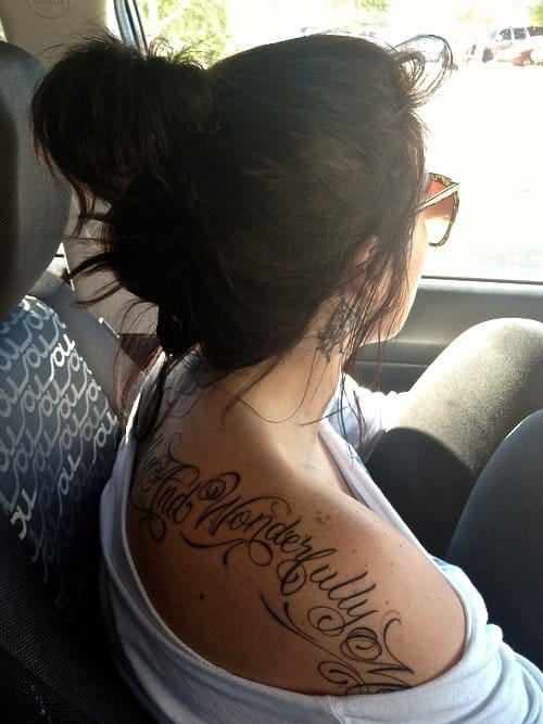 "Girls rock tattoos like no one else can, like this ""fearfully and wonderfully made"" stunning script."