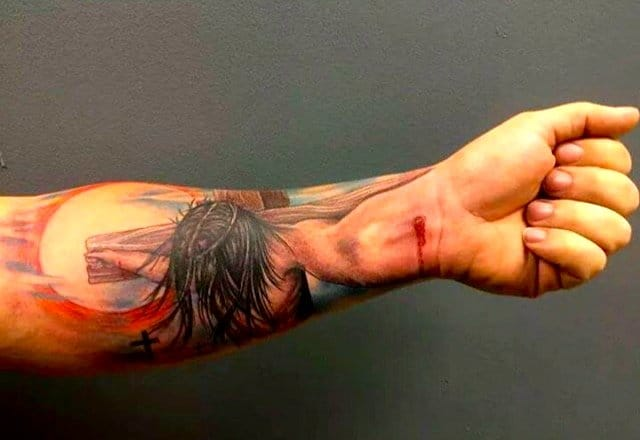 Stunning Jesus forearm tattoo by artist Tony Wheeler.