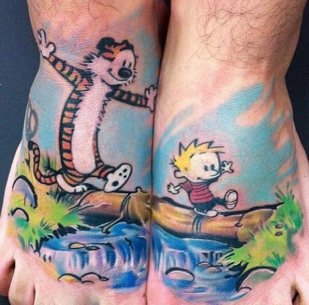 How cute is this Calvin and Hobbes split tattoo by Ben Ochoa?
