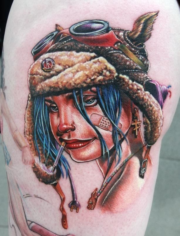 The tattoo of Hatty is inspired by the same comics than this one by Cecil Porter : Tank Girl.