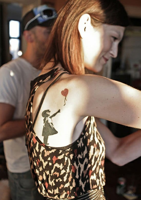 The girl with the heart balloon is one of Banksy's most famous street painting, and also one of the most coveted for tattoos. Photo by Loonyworld.