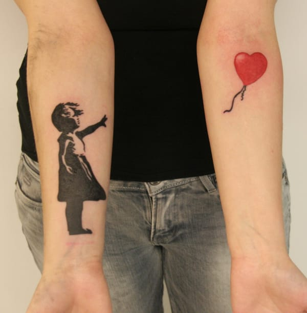 The balloon girl can make a good split tattoo, here by Tuomas Koivurinne.