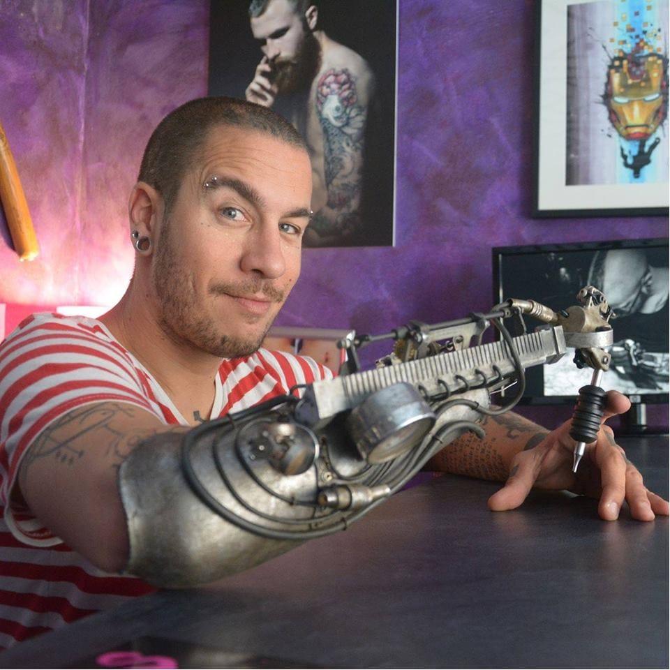 French Tattoo Artist JC Sheitan Uses A Custom Prosthetic Arm To Tattoo