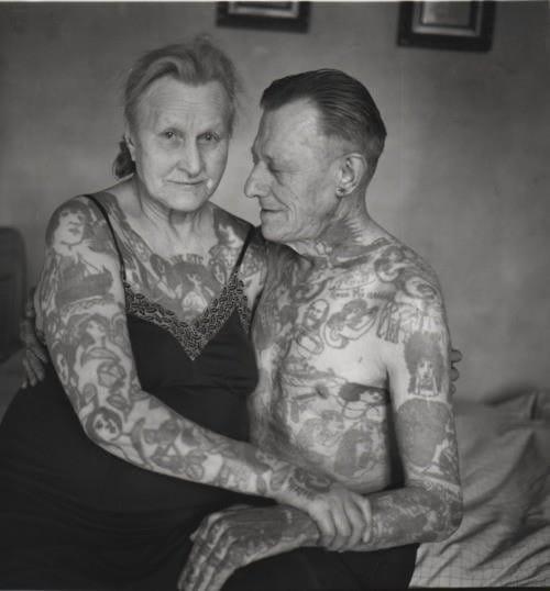 Tattooed elderly couple