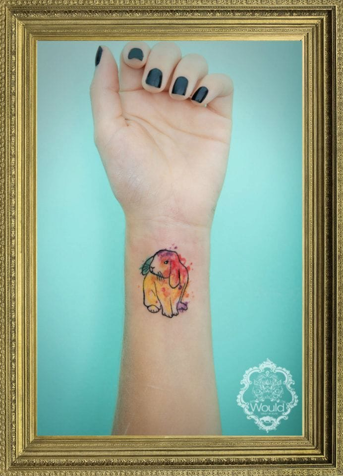 Small watercolor tattoo by Candelaria Carballo.