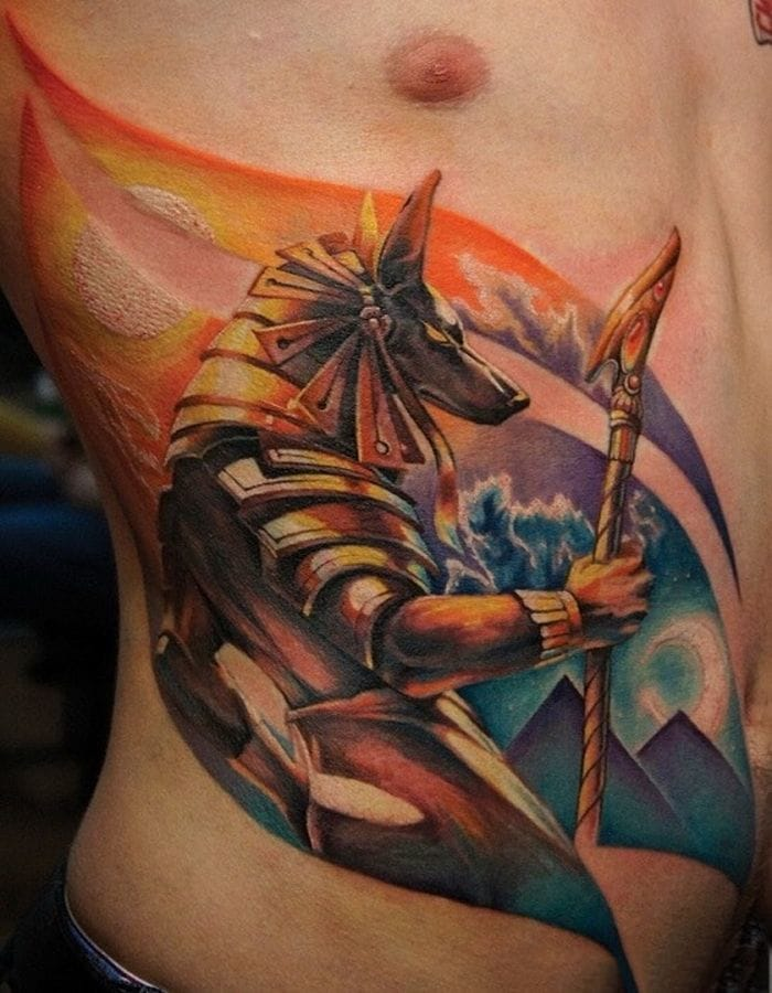 The mighty Anubis, the jackal god of the deads... Do you know who did this colorful tattoo?