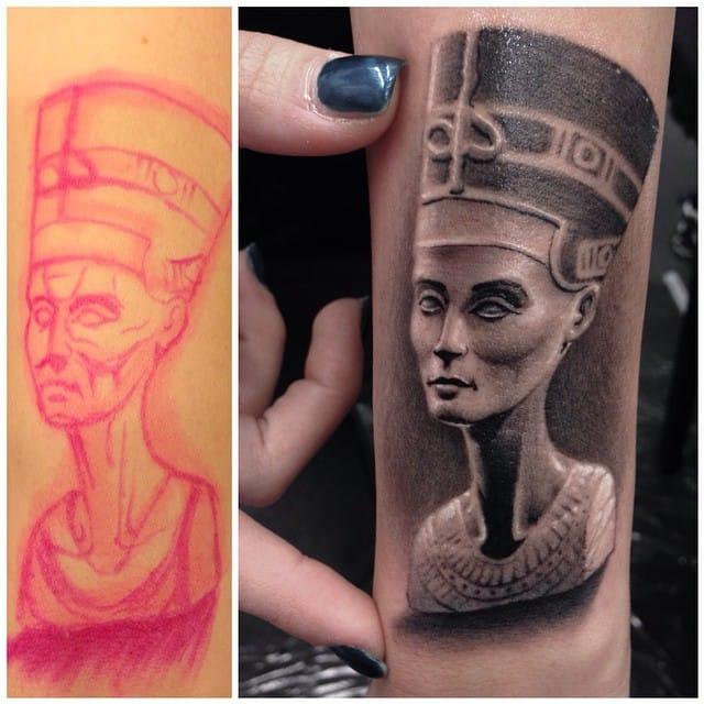 A small delicate tattoo of Queen Nefertiti by Clod the Ripper.